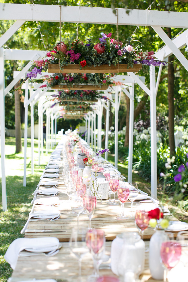 Outdoor farmstyle dining. Pink, purple and green Natte Valleij Stellenbosch Wedding by Adene Photography