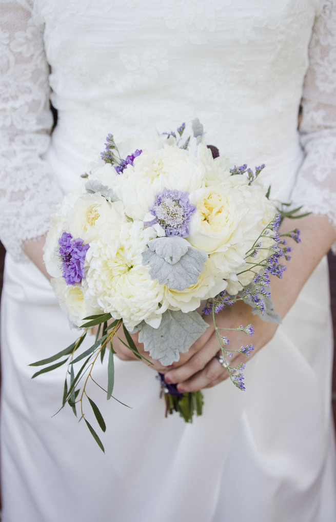 White chrysanthemums, white garden roses, lambs ear and purple filler flowers bridal bouquet
