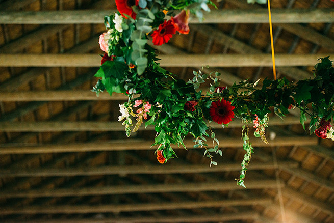 Floral chandelier. Woodlands Winter Wedding in deep blue, burgundy and emerald green // Knit Together Photography