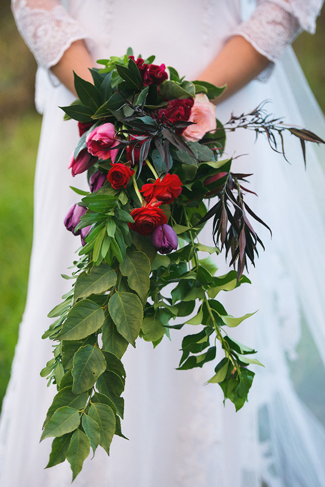 Cascading bride bouquet. Woodlands Winter Wedding in deep blue, burgundy and emerald green // Knit Together Photography