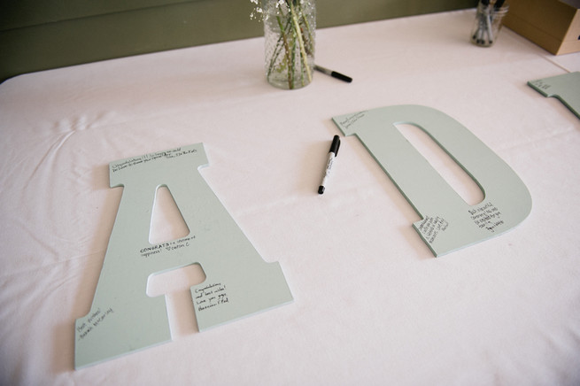 Guest Book Idea - couples surname spelled out on board, signed by guests, then framed afterward.