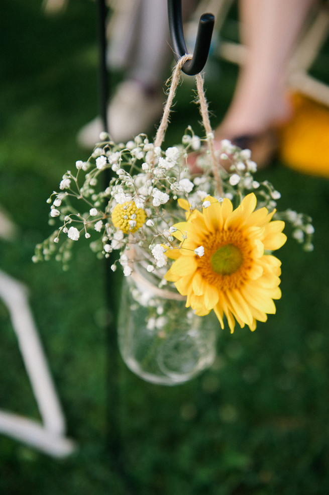 Sunflower and babys breath aisle flowers in jar.  Coral Navy Mustard Wedding / Meredith McKee Photography