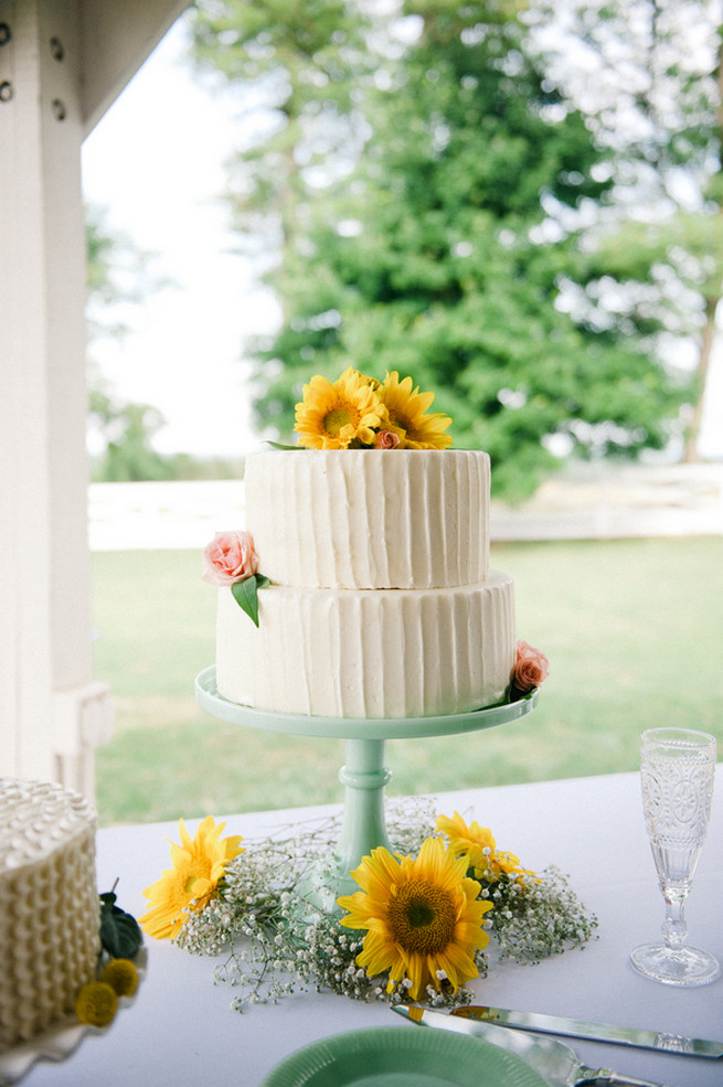 Wedding cake sunflower toppers.  Coral Navy Mustard Wedding / Meredith McKee Photography