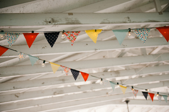 Bunting.  Coral Navy Mustard Wedding / Meredith McKee Photography