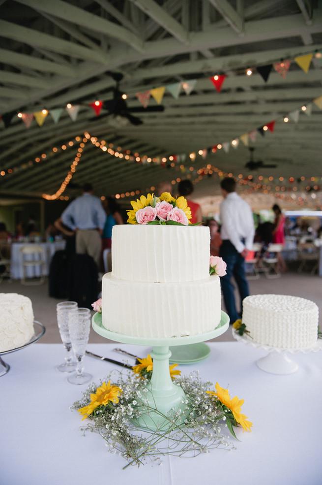 Wedding cake.  Coral Navy Mustard Wedding / Meredith McKee Photography