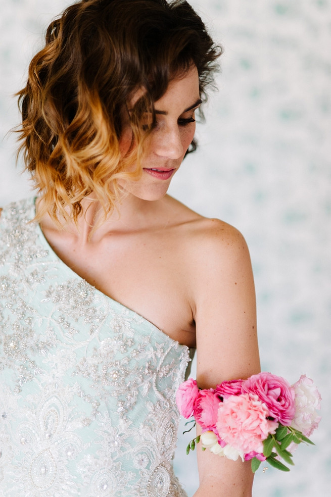 Bridal corsage of pink ranunculus, carnations and roses