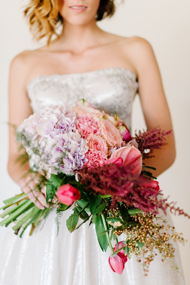 Purple hydrangea, red tulips, pink lilies, blush carnations and cream roses make up this fabulous bouquet!