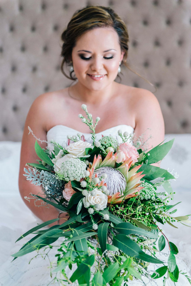 King Protea, Queen Annes Lace, Jasmine, Lambs Ear and rose wedding bouquet.