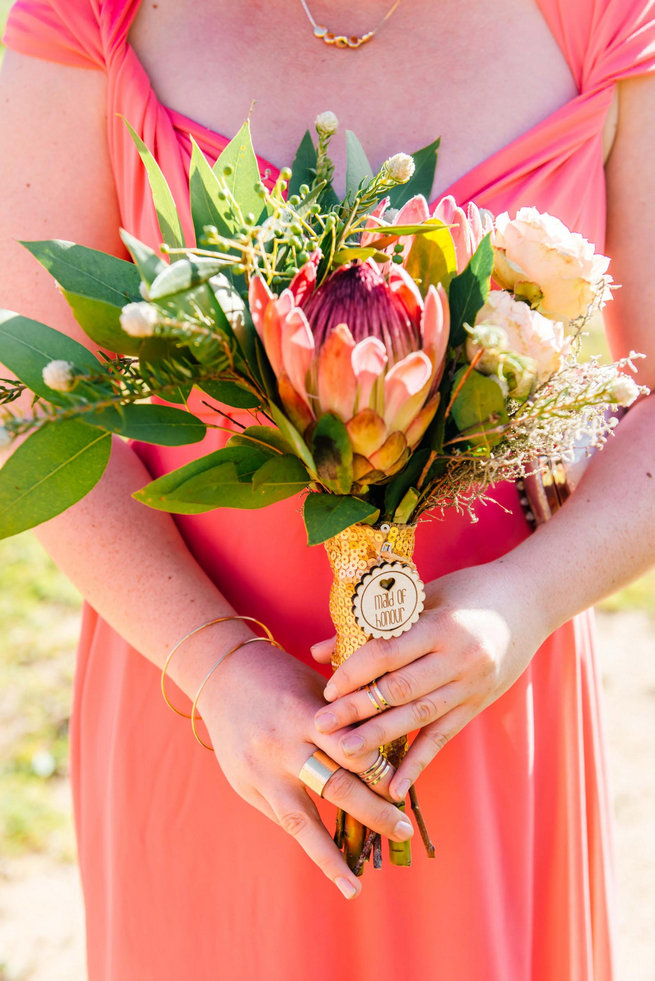 Protea Bouquet and peach bridesmaid dress /Langkloof Roses Wedding, Cape Town - Claire Thomson Photography