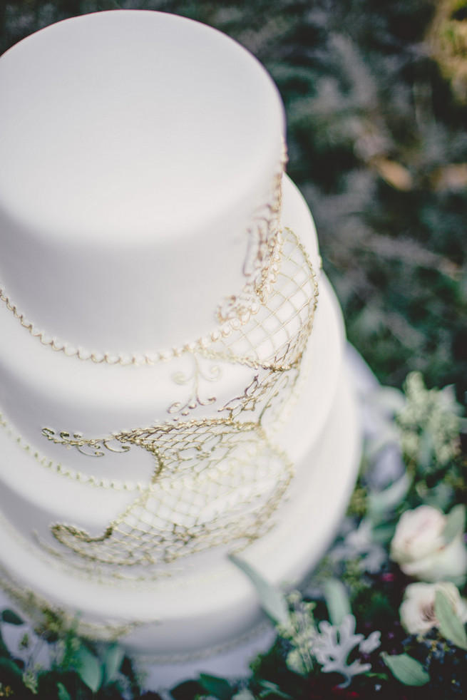 White wedding cake with gold applique Marsala Wedding Tablescape - RedboatPhotography.net