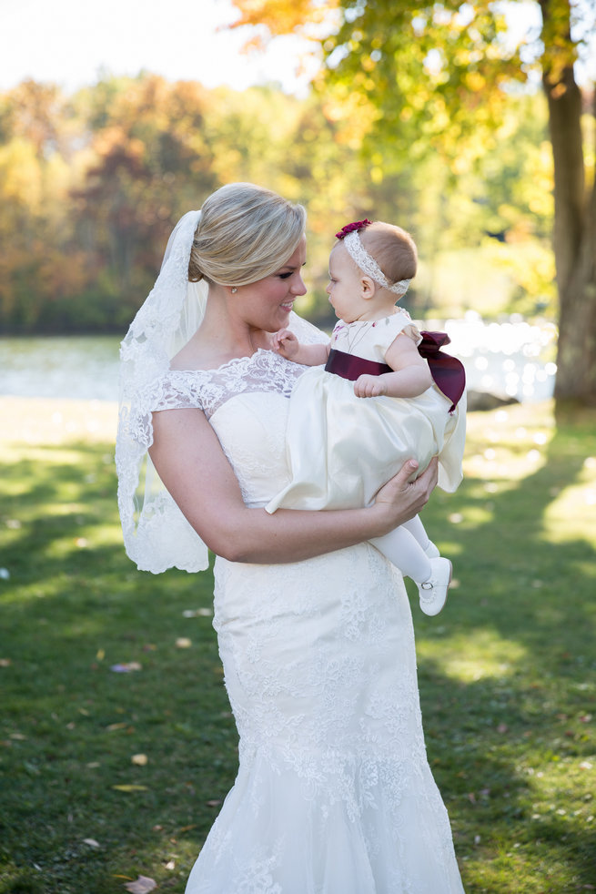 Bride with flower girl  - Beautiful Burgundy and Tan Wedding - Molinski Photo