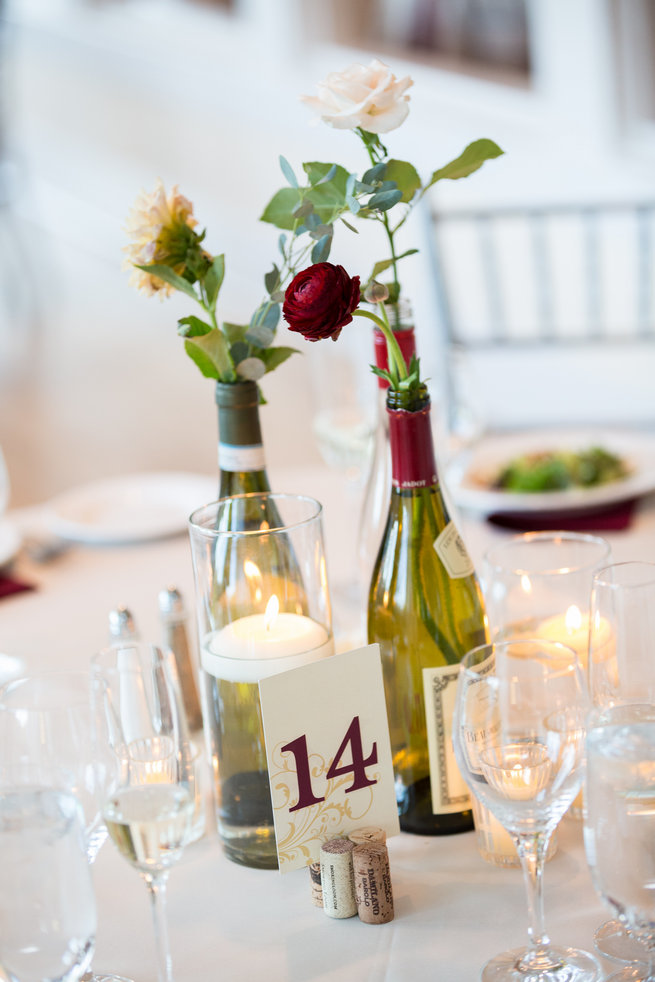 Wine and cheese themed wedding - wine bottles with flowers - Beautiful Burgundy and Tan Wedding - Molinski Photo