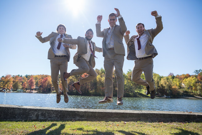Groom and groomsmen jumping in air   - Beautiful Burgundy and Tan Wedding - Molinski Photo