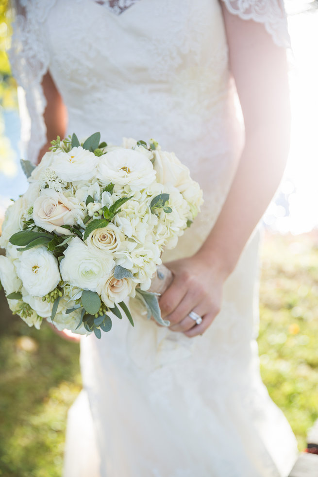 White roses, white ranunculus, white hydrangea, eucalyptus and lambs ear bouquet.  Beautiful Burgundy and Tan Wedding - Molinski Photo