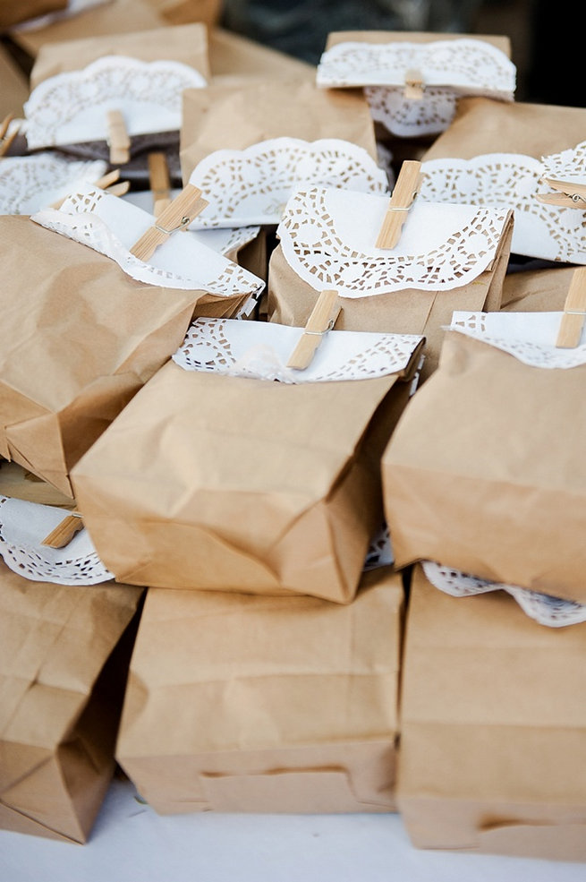 Brown paper favor bags with doily and clothes peg popcorn favors / Coral and Green South African Wedding // D'amor Photography