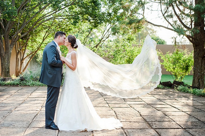 Veil caught in breeze / Coral and Green South African Wedding // D'amor Photography