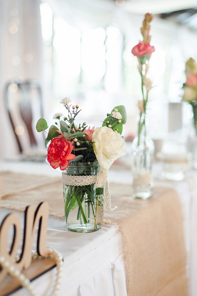 Peach carnation, peach rose and eucalyptus in jar wrapped with lace / Coral and Green South African Wedding // D'amor Photography