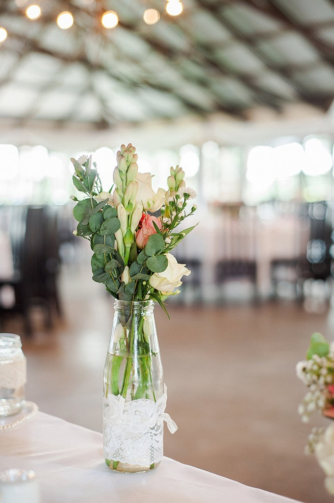 Eucalyptus and snapdragons in vase / Coral and Green South African Wedding // D'amor Photography