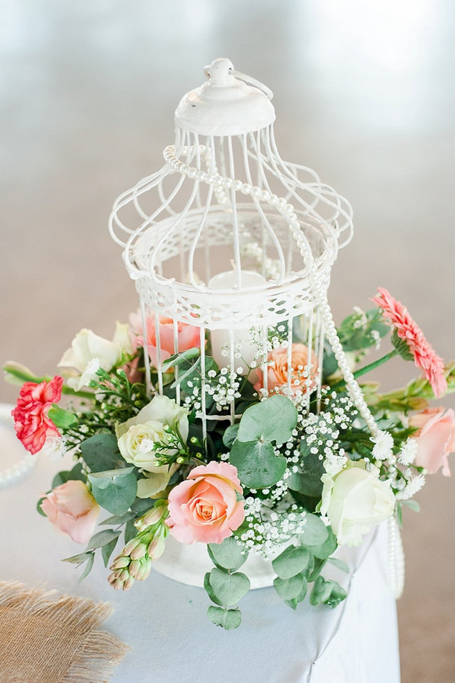 White birdcage with peach and green flowers / Coral and Green South African Wedding // D'amor Photography