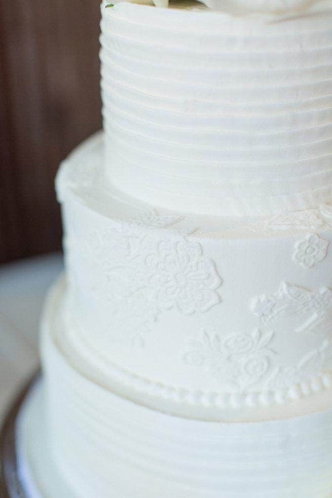 White wedding cake pattern. Modern Urban Wedding at Old Cigar Warehouse / Ryan and Alyssa Photography