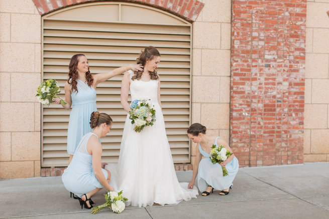 Bride and bridesmaids in pretty pale blue. Modern Urban Wedding at Old Cigar Warehouse / Ryan and Alyssa Photography
