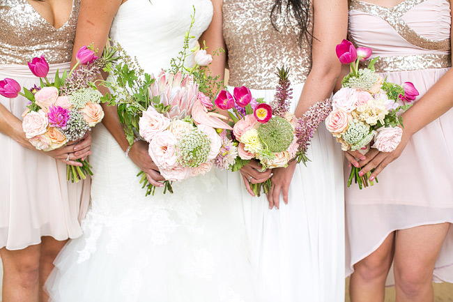 Breathtaking Wedding Bouquet Recipe: Pink King Protea, pink tulips, blush pink garden roses, pink lily, queen annes lace and greens. Click to blog for more gorgeous bouquet ideas.