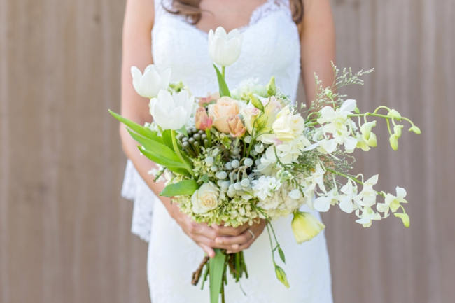 Breathtaking Wedding Bouquet: White Tulips, Brunia Balls, Roses and Lisianthus. Click to blog for more gorgeous bouquet ideas.