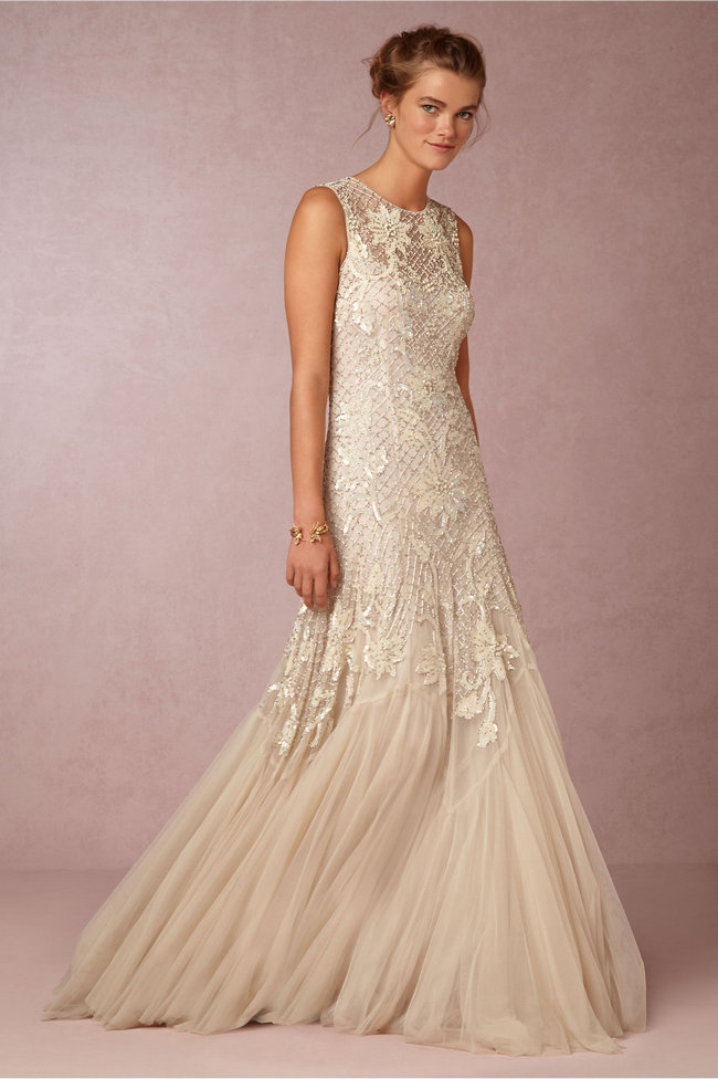Chic, Sophisticated Wedding Dresses for Romantics: The Exquisitely beaded Wesley Gown has a pearlescent lattice and vintage-inspired flora, with an airy, layered tulle hemline falling delicately over the toes.