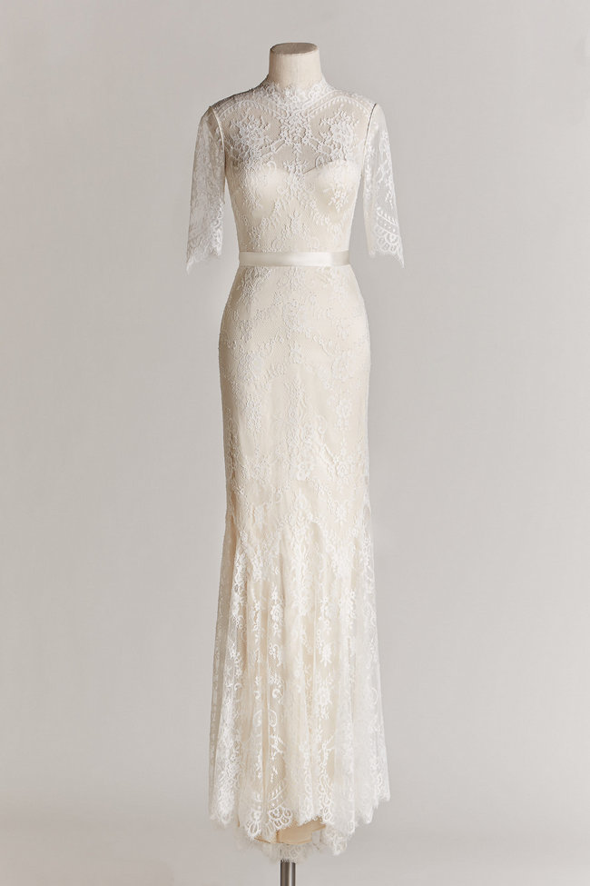 Chic, Sophisticated Wedding Dresses for Romantics: This illusion high-neck gown is a true masterpiece with half-sleeves, delicate allover lace, and a satin ribbon which cinches the waist for added definition.
