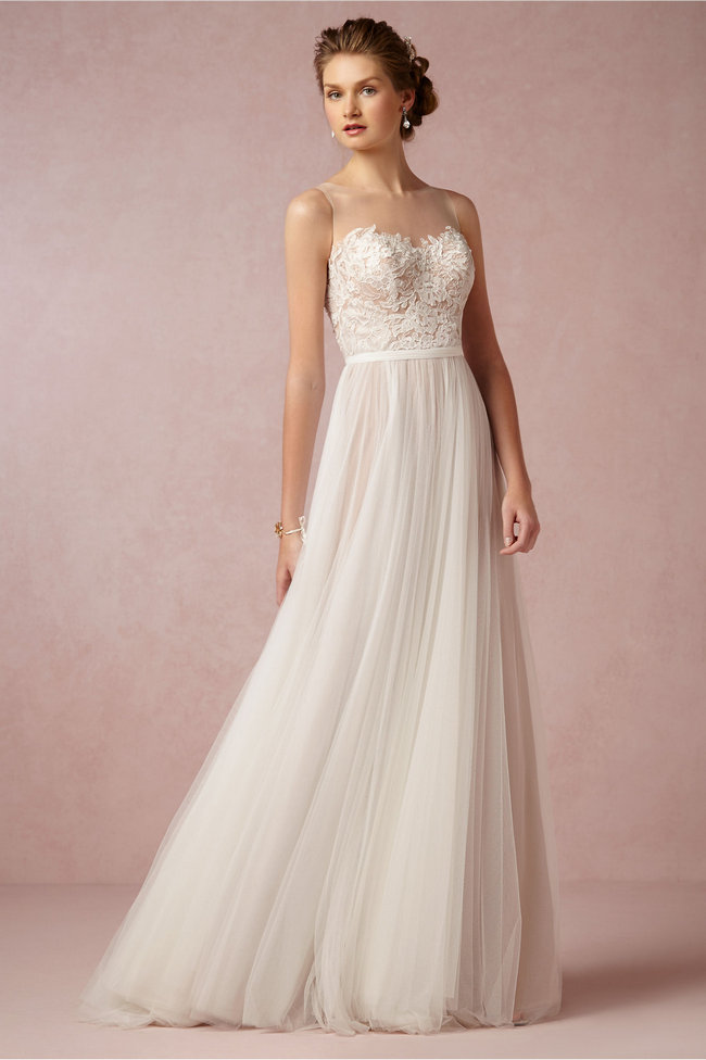 Chic, Sophisticated Wedding Dresses for Romantics: The Penelope gown has all the elements of a fairytale gown: soft illusion neckline, floral-covered bodice, flowing tulle skirt, sweeping train, and a sash to tie it all off.