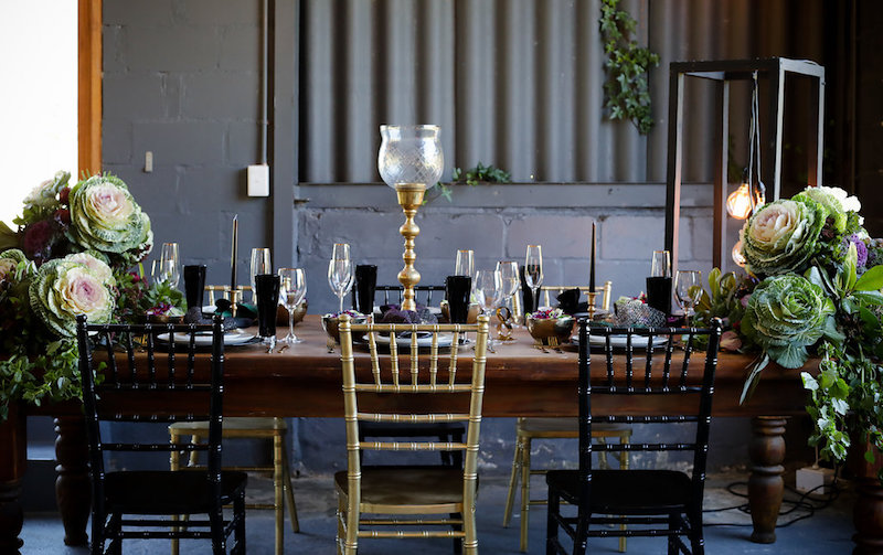 Plum purple black and gold wedding decor