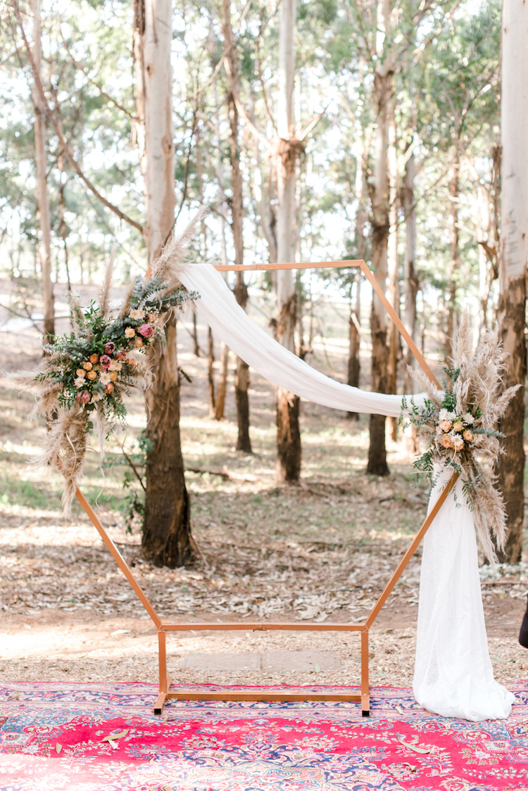 Forest Wedding with Geometric Wedding Arch and pampas grass