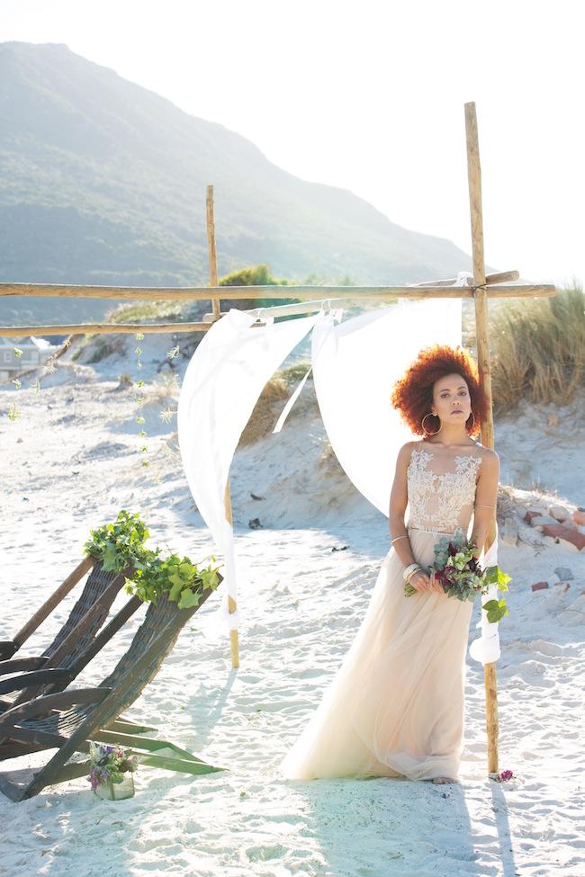 Boho beach wedding ceremony and decor