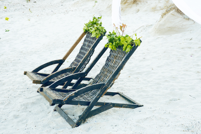 Boho beach wedding reception chairs and decor