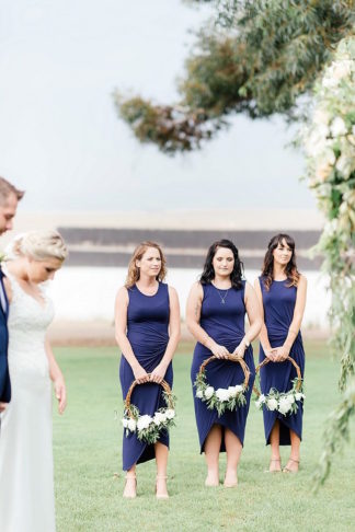 Navy blue bridesmaids dresses with floral wreaths instead of bouquets