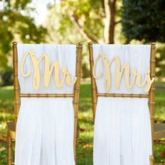 Lazer cut script style calligraphy Mr Mrs Wedding Chair Signs. See 20 more cute and creative ideas here: https://confettidaydreams.com/mr-and-mrs-signs/