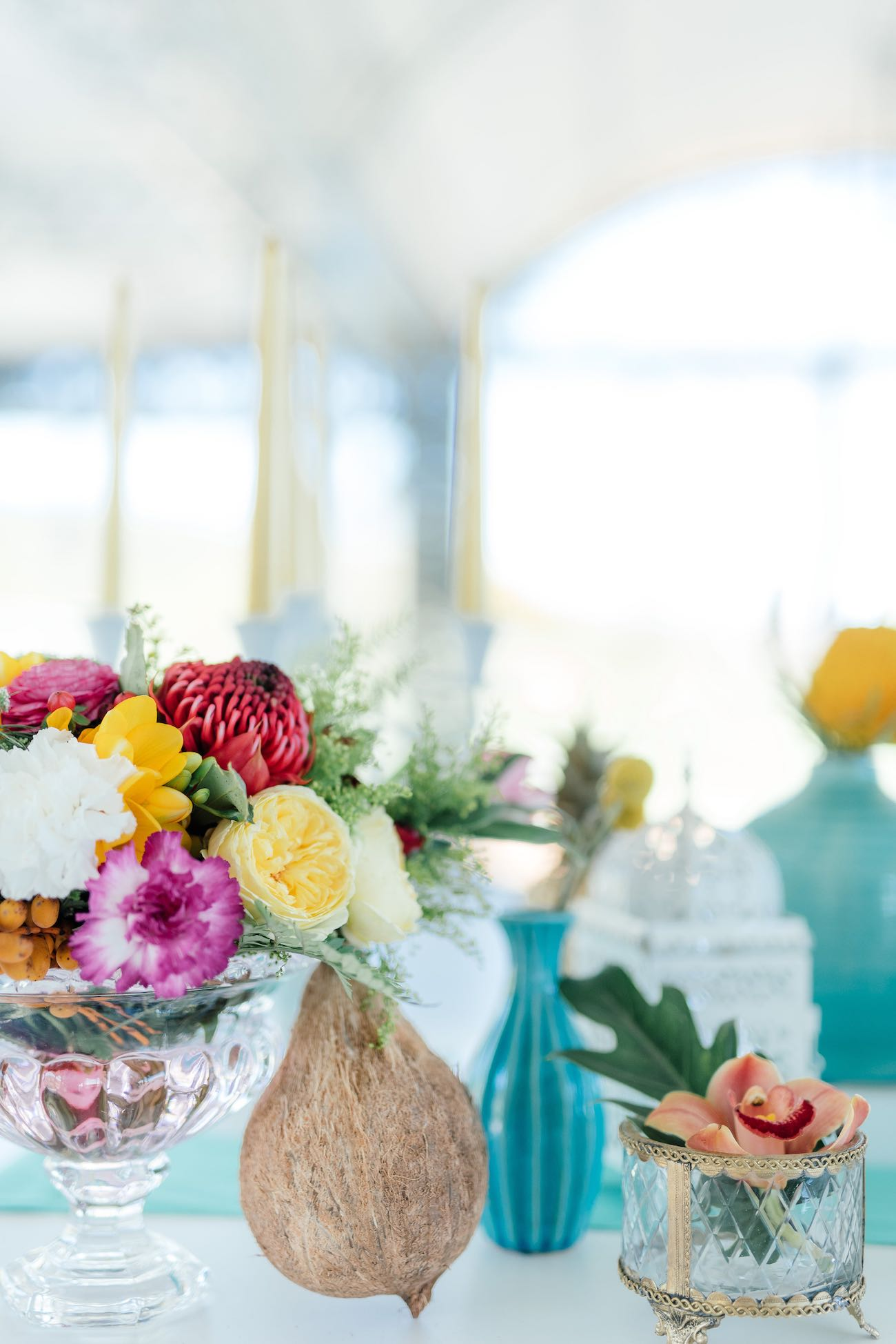 Yellow garden roses, red Protea, yellow tulips, pink blooms and ferns for a tropical wedding theme. Click for the most absolutely gorgeous Tropical Wedding ideas ever!