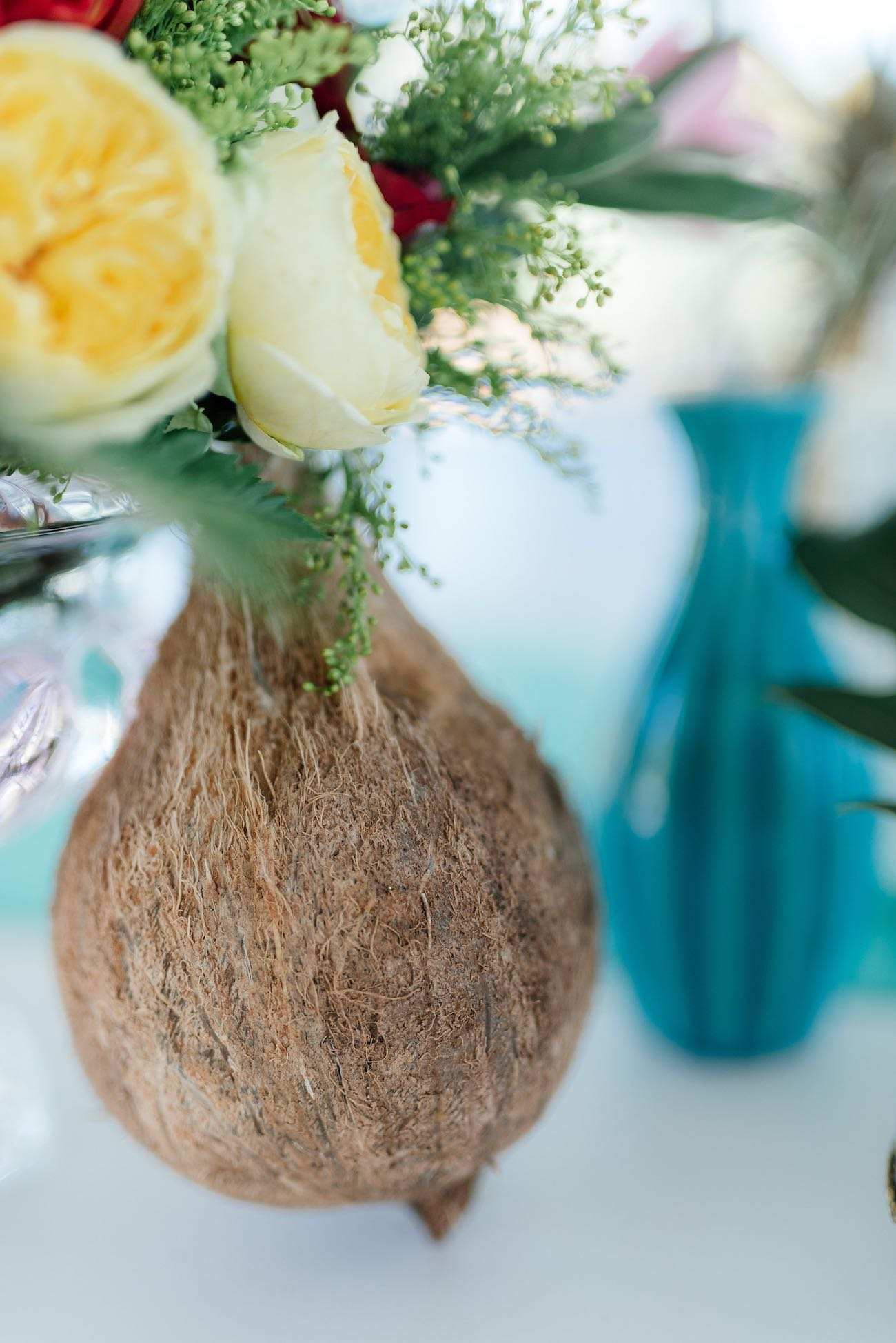 A coconut style vase for tropical flowers. Click for the most absolutely gorgeous Tropical Wedding ideas ever!