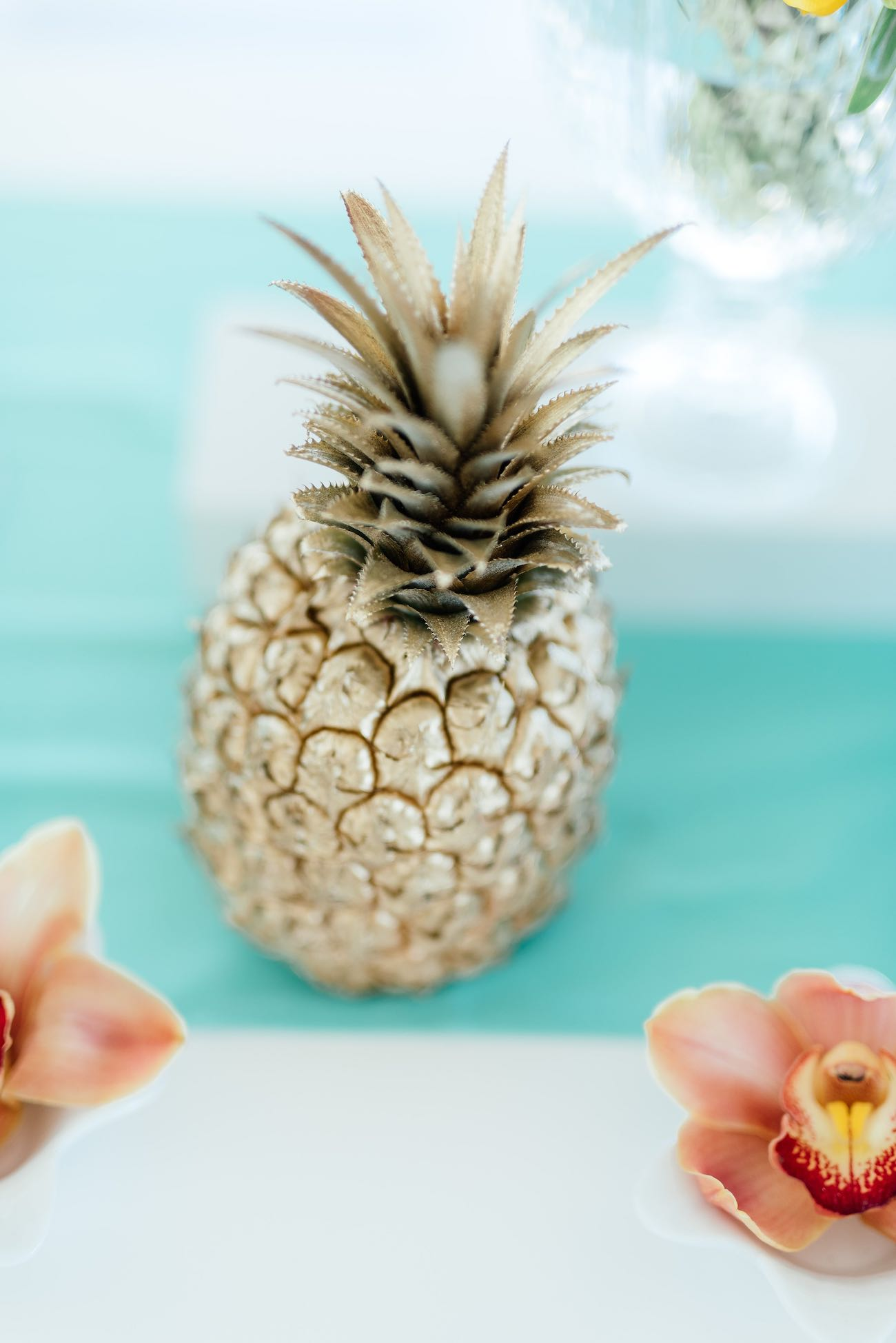 Gold painted pineapple. Click for the most absolutely gorgeous Tropical Wedding ideas ever!